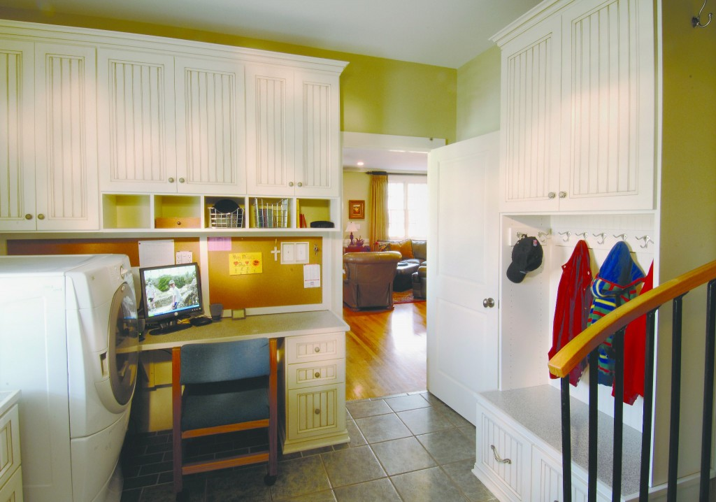 White custom entryway mudroom cabinetry.