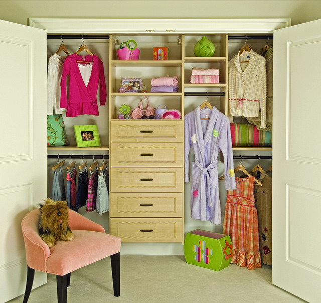 Girls reach-in closet with dress up clothes