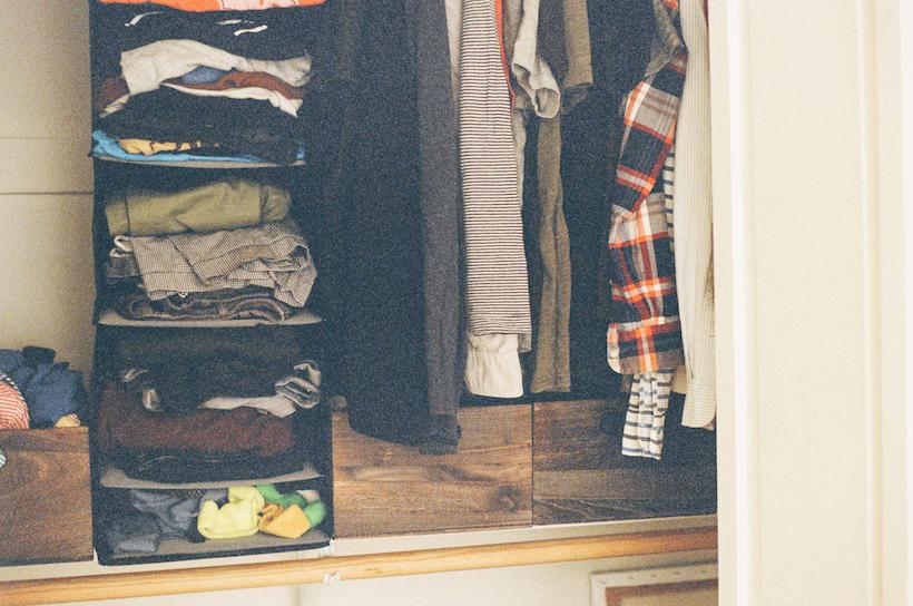 Men's closet with hanging organizer