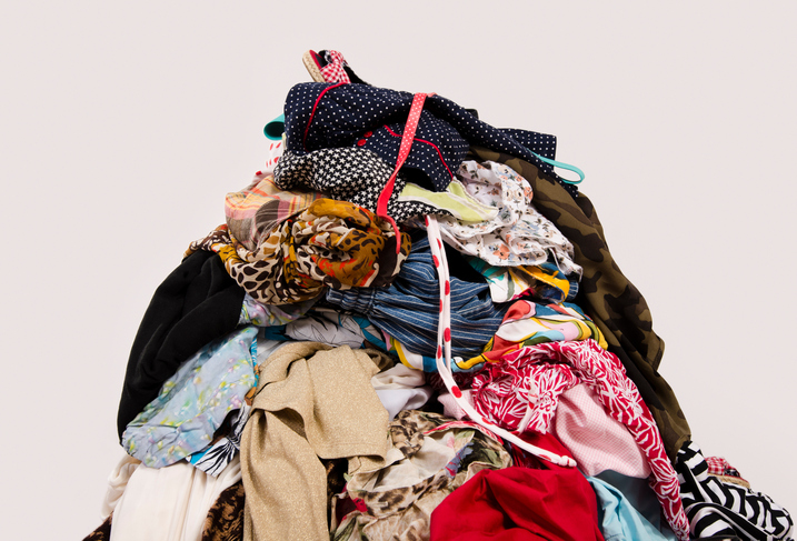 Untidy pile of clothes on the ground