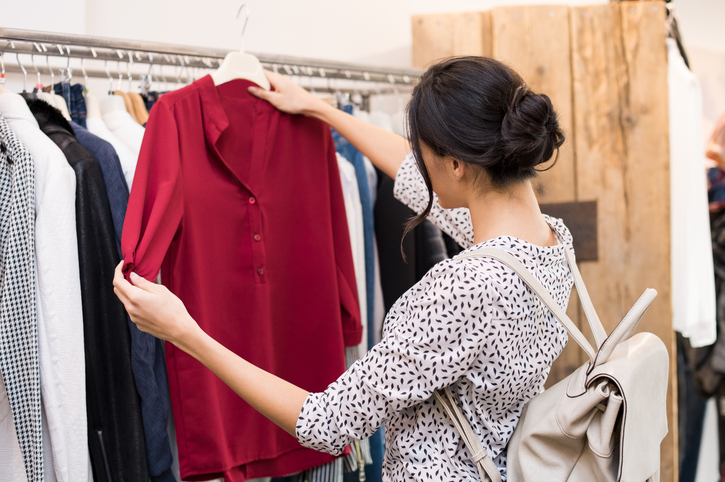 Woman shopping and deciding on purchase