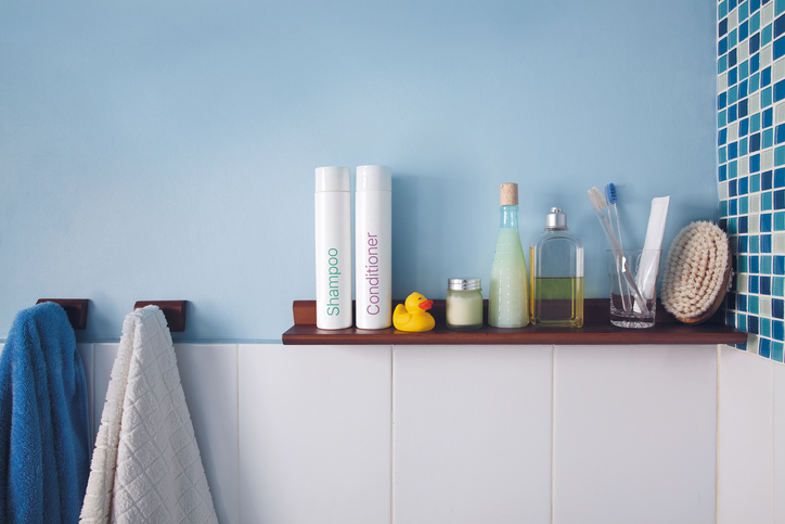 Organized bathroom shelf and hooks