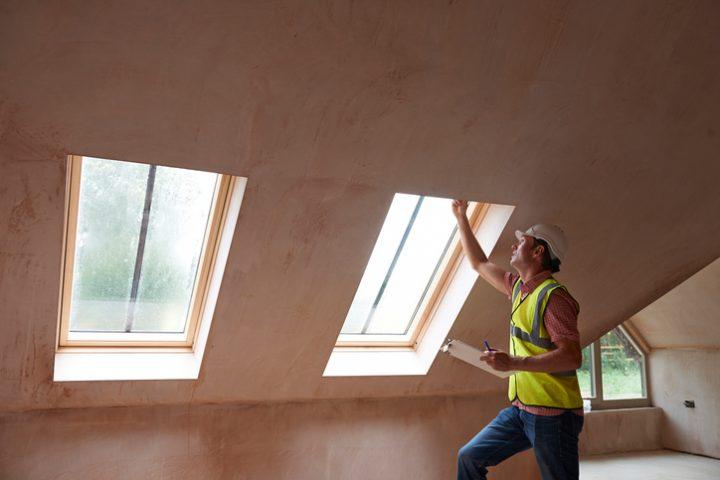 Builder inspecting home windows