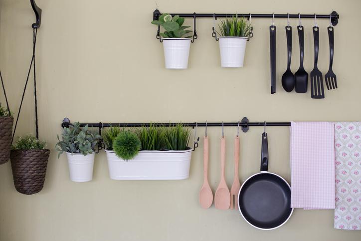 Hanging kitchen utensils on wall