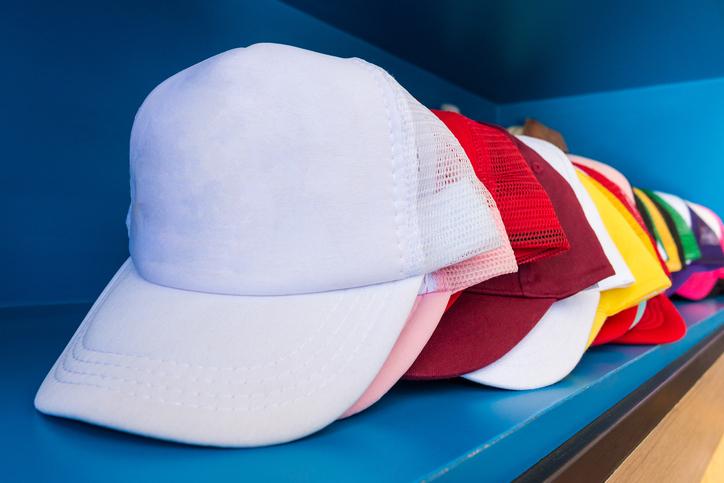 colorful hats on a shelf