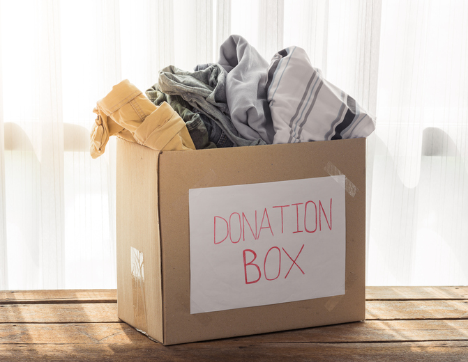 Clothing donations in cardboard box
