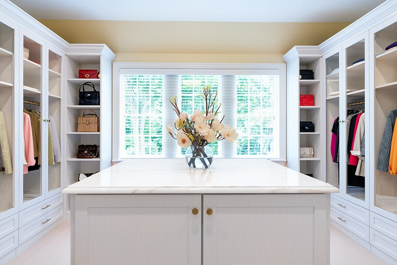 boutique walk-in closet with island