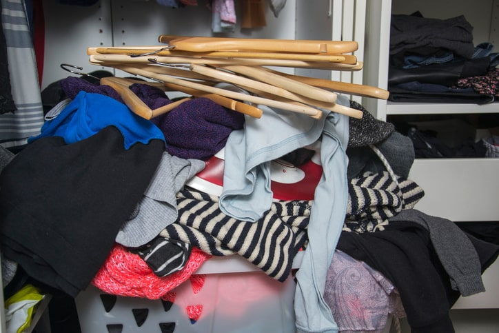 decluttering clothes in bedroom closet