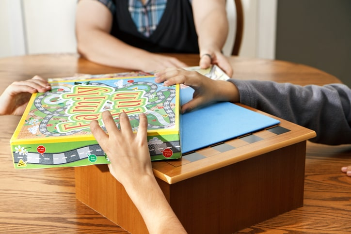 family picking a board game
